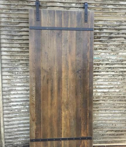 Reclaimed barn wood rolling door