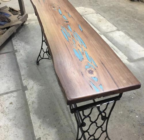 Live edge console with sewing machine base and turquoise inlay